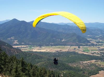 Paraglider Flying Woodrat Mountain